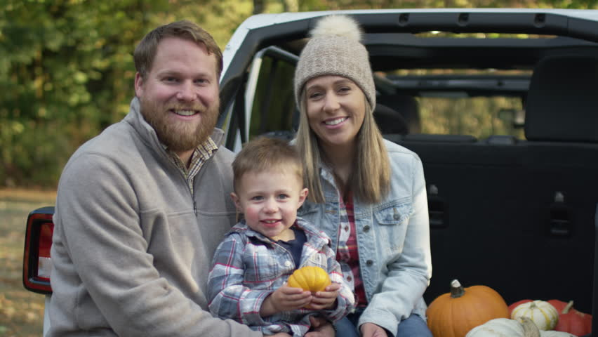 Portrait Of Happy Family Smiling, Sitting In Back Of SUV With Their Pumpkin Patch Haul, Slow Motion | Shutterstock HD Video #1018194727