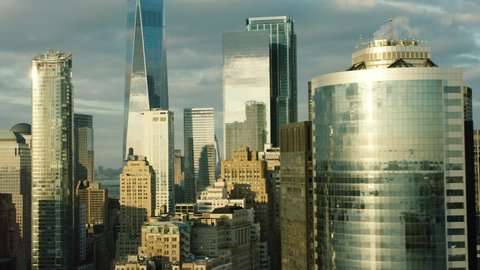 Aerial view of tall buildings and skyscrapers in downtown, Manhattan, New York City, bright day lighting. Wide shot. 4k shot with a RED camera.