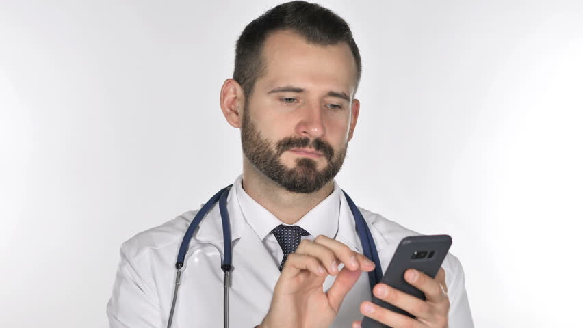Old Doctor Browsing Smartphone, White Background   Shutterstock HD Video #1018295317