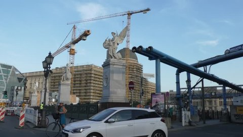 Berlin, Germany - September 20, 2018: Camera car along Unter den Linden, with the Berlin City Palace construction site and the Humboldt Box, a futuristic museum structure