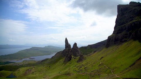 Travellers viewpoint Scotlands Old Man of Storr rock pinnacles on the Isle of Skye landscape view over the Sound of Raasay UK