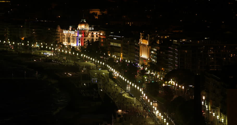 NICE, FRANCE - SEPTEMBER 25, 2014 Aerial View of Nice City People Walk on Famous Promenade and Cars Traffic Night