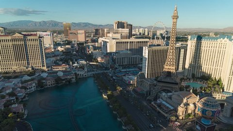 Las Vegas, Nevada USA Oct 22, 2018  An aerial time lapse video from day to night view of the Las Vegas Strip with the ferris wheel and and Paris's eiffel tower overlooking the Bellagio fountains.