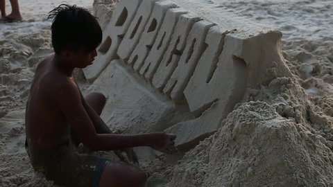 Boracay, Aklan / Philippines - 02 27 2017: Sandcastle builder on White Beach in Boracay, Philippines