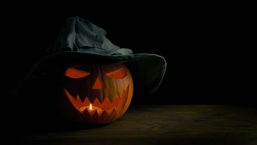 Scary Faced Pumpkin With Witches Hat | Shutterstock HD Video #1018630027