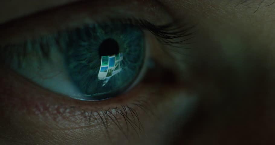 Close up macro eye screen reflecting on iris young man browsing online at night