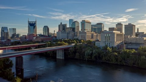 Tennessee Nashville Aerial Cityscape hyperlapse flying low over river and over downtown buildings 10/18