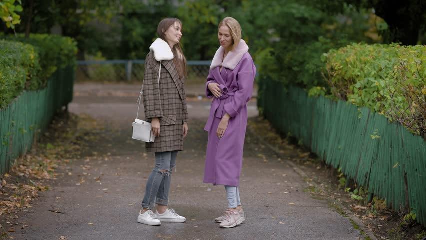 Two women speaking in park | Shutterstock HD Video #1018795357