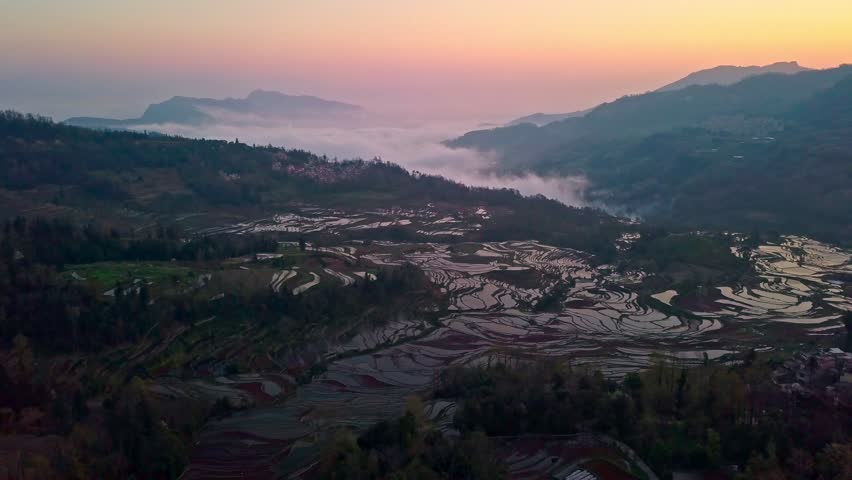 Aerial view from a drone of rice terrace at sunrise, Yuanyang, Yunnan, China | Shutterstock HD Video #1018832407
