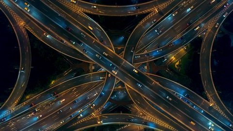 Yananlu Road overpass bridge with traffic at night aerial view from drone in Shanghai, China.