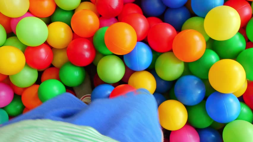 Multicolored balls in the children's pool. A child walks among a variety of multi-colored plastic balls, a subjective camera | Shutterstock HD Video #1018878217