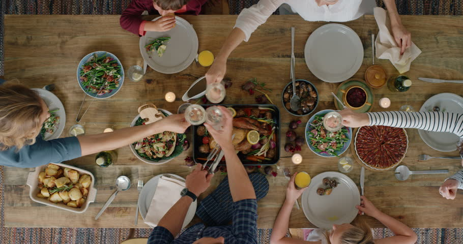 Family eating thanksgiving meal together enjoying raising toast tasty homemade lunch holiday celebration feast overhead | Shutterstock HD Video #1018898257