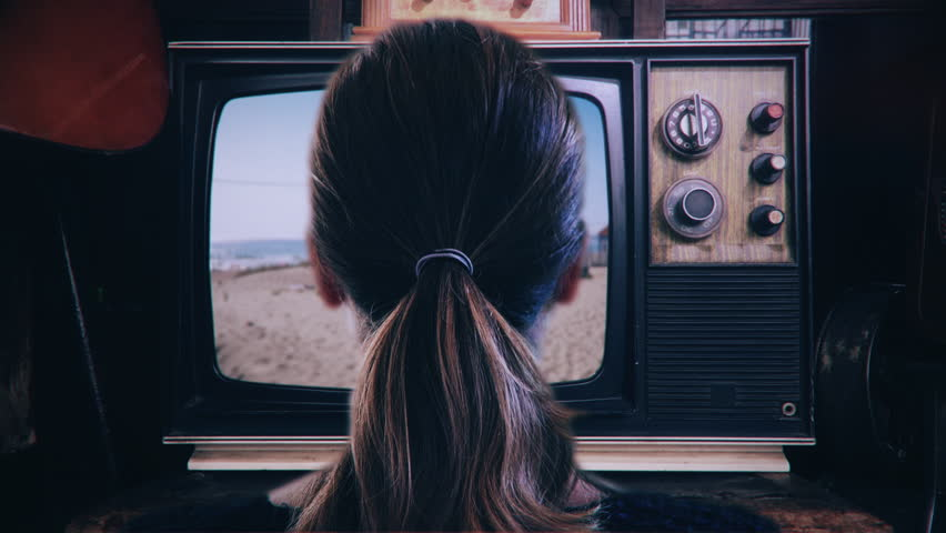 Girl Watching TV Retro Technology Television. Head shot of a young woman watching old vintage television. Shot behind model shoulders. | Shutterstock HD Video #1019020417