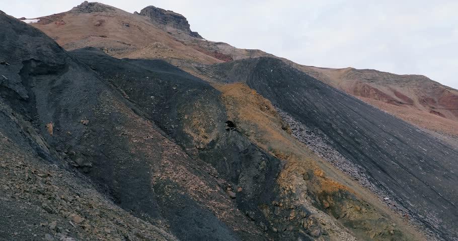 Pyramiden, Svalbard - October 22, 2017: Soviet era coal mine exposed shaft, zoom in to damage