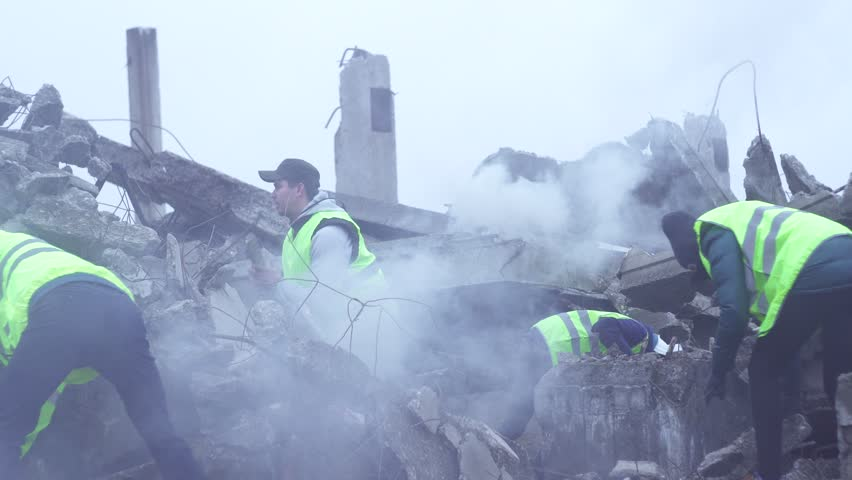 Rescue workers dismantle the rubble after the earthquake