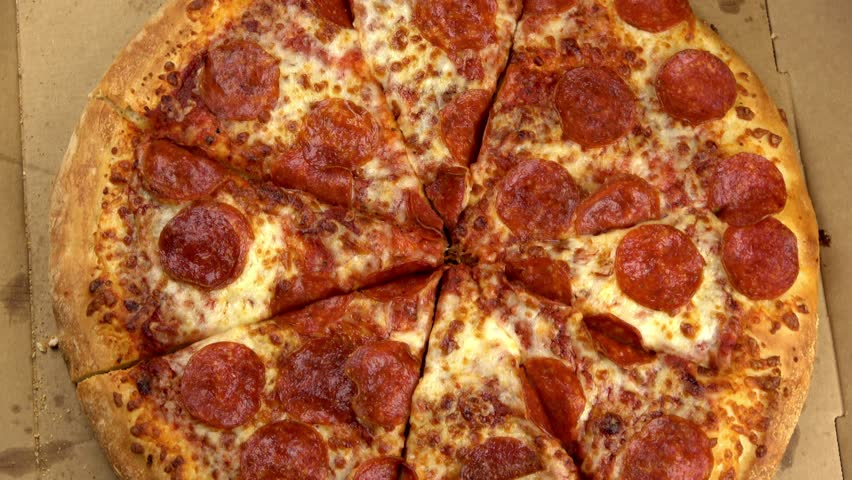 Pepperoni pizza in box spinning video close up #1019196577