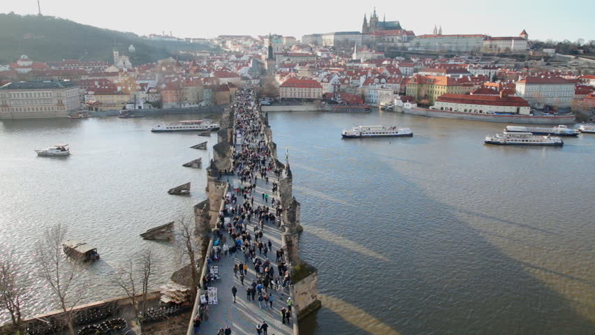 Prague, Chezh Republic, Winter. People having promenade by Charles Bridge in Prague. Winter Season. Beautiful ancient architecture of old town. | Shutterstock HD Video #1019302387