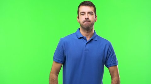 Man on green screen chroma key background is suffering with cough and feeling bad