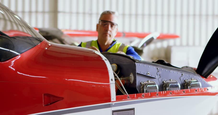 Male Engineer repairing aircraft in hangar   Shutterstock HD Video #1019509357