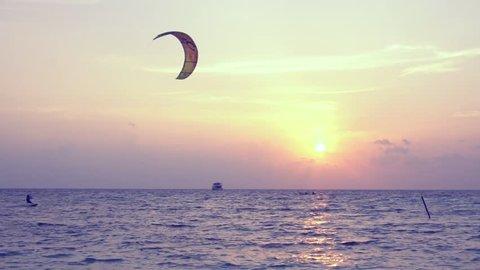 Maafushi Island, Maldive, - 11 APRIL 2017: Kite surfer riding with kitesurf on sunset. Maldivian travel destinations