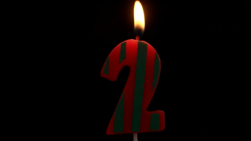 Burning Birthday Candle Isolated On Black Background Number 2