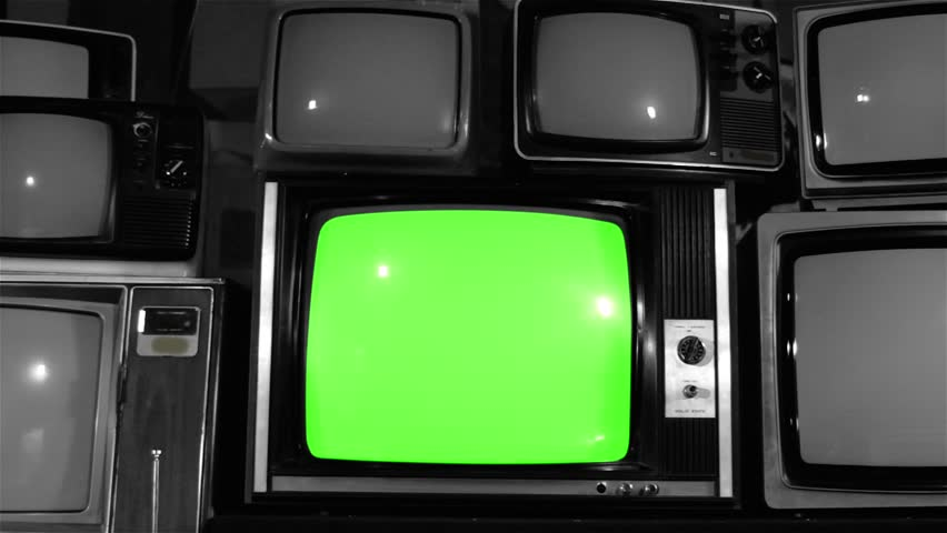 """Old TV Green Screen over 80s TVs. Noir Tone. Dolly Out Fast. You can Replace Green Screen with the Footage or Picture you Want with """"Keying"""" effect in After Effects (check out tutorials on YouTube).  