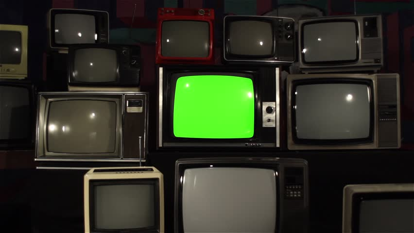"80s TV Green Screen with Many 80s Tvs. Dolly In Fast. Ready to Replace Green Screen With any Footage or Picture you Want. You Can Do it With ""Keying"" (Chroma Key) Effect in After Effect. 