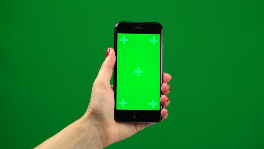 Female hand holding the newest smartphone on green screen | Shutterstock HD Video #1019712157