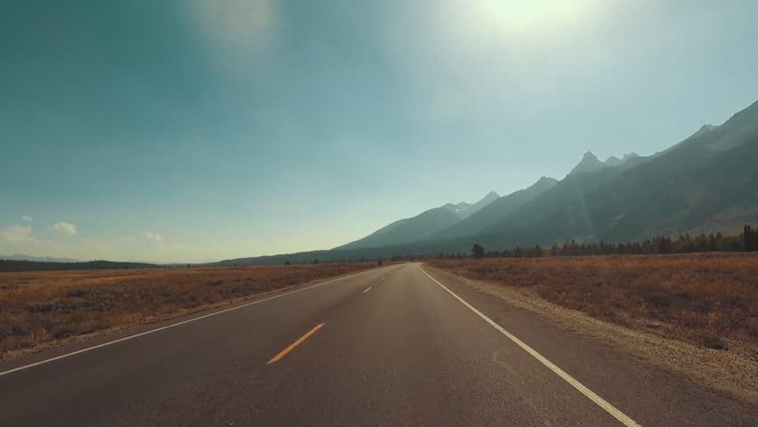 Driving a Car through Grand Teton park, back light, Point of View - Mounted 2.7k Ultra HD footage | Shutterstock HD Video #1019719627