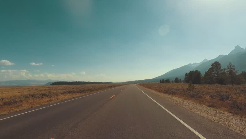Driving a Car through Grand Teton park, back light, Point of View - Mounted 2.7k Ultra HD footage | Shutterstock HD Video #1019719957
