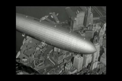 New York , United States of America.  About 1936. The Hindenburg Zeppelin flies over the city of New York