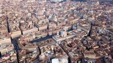 Aerial drone view of iconic landmark Piazza Navona (Square) featuring Fountain of the Four Rivers with an Egyptian obelisk and Sant Agnese Church in the heart of Rome, Italy