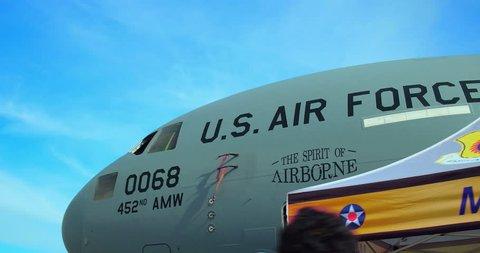 LONG BEACH, CALIFORNIA, USA - NOVEMBER 18, 2018: People discover Air Force McDonnell Douglas C-17A Globemaster III large military transport aircraft at Festival of Flight air show, Long Beach, CA, 4K
