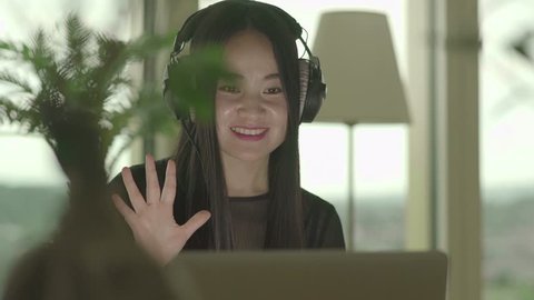 Happy Female Person Listening to Music Video Clip with Headphones online
