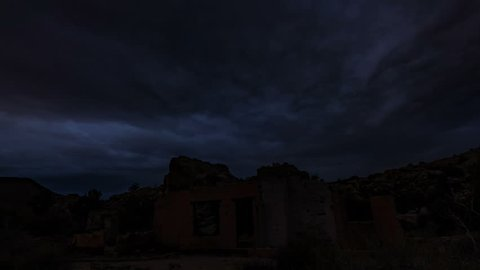 Astrophotography Timelapse with zoom out motion of abandoned truck wreck from Gold Rush in desert in Joshua Tree National Park, California