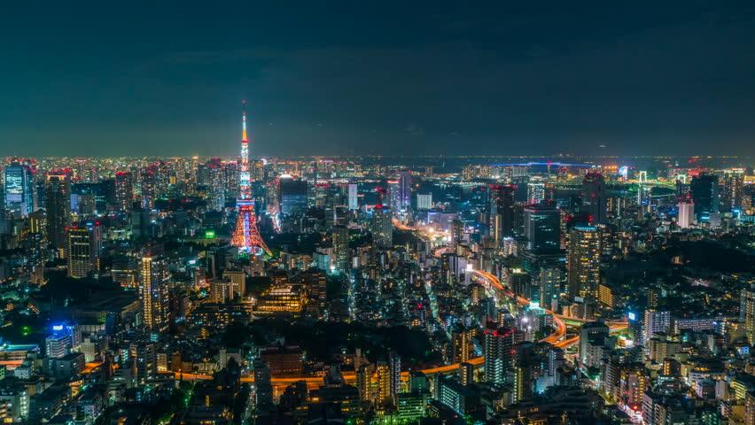 Timelapse of iconic Tokyo Tower in vast sea of city lights in Tokyo, Japan | Shutterstock HD Video #1020043657