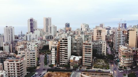 Aerial footage of downtown Beirut, Lebanon, at the sunset. Beirut skyline with skyscrappers in the evening, drone footage. Camera ascending over Beirut downtown.