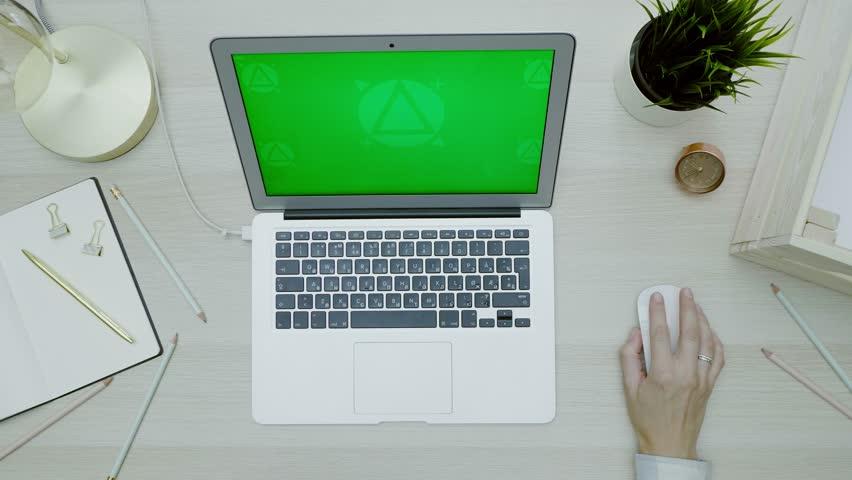 Woman using her laptop with green screen | Shutterstock HD Video #1020159757