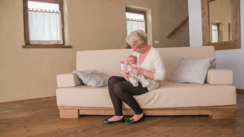 Woman And Newborn Sit On Stock Footage Video 100 Royalty Free