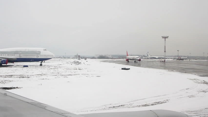 Moscow, Russian Federation – March 05: View from airplane to the Domodedovo International airport. Domodedovo International Airport is one of the biggest airports in Russian Federation. | Shutterstock HD Video #10203137