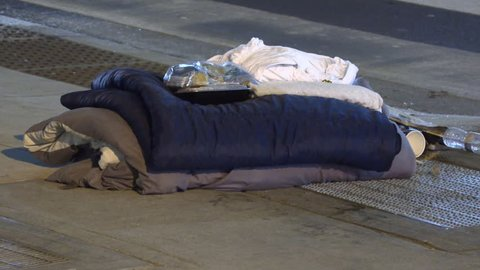 Toronto, Ontario, Canada November 2018 Desperate homeless people on streets of wealthy Toronto business district at night in severe cold weather