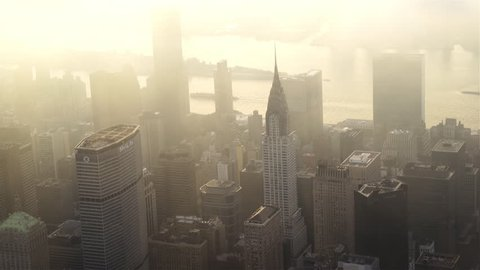 New York City Circa-2015, aerial view of Midtown Manhattan, featuring the Chrysler Building, UN Building and Metlife Building in a hazy fog at sunrise