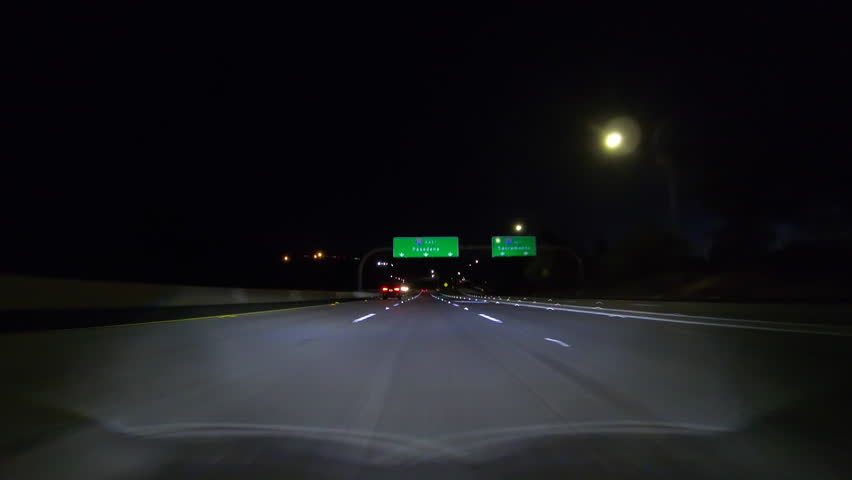 Los Angeles night freeway driving under Pasadena Sign on the 210 Freeway east in the San Fernando Valley.   | Shutterstock HD Video #1020357877