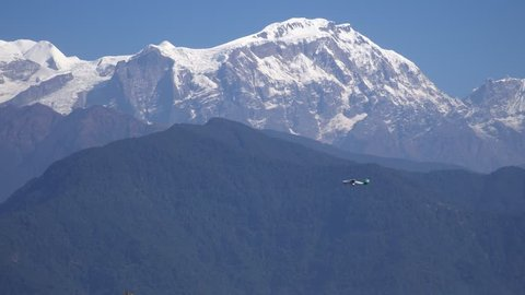 Small Airplane Flying Over Himalayan Mountain Range