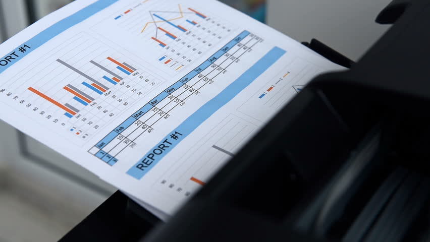 Business Report And Investment Charts Printed On Printer. Finance And Business Concept