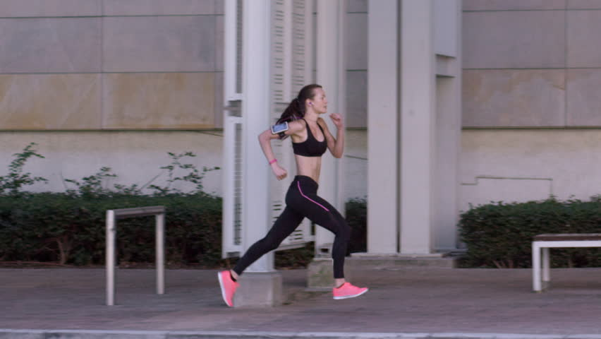 Athletic fitness woman running in urban city RED DRAGON #10204337