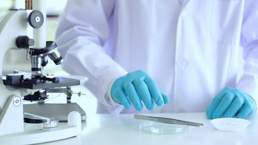 Scientist working at lab using tool counting drug  #1020550447
