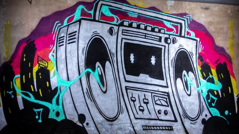 timelapse of a graffiti artist spraying a boom box ghettoblaster on a wall. the creation of the artwork grows step by step without seeing the artist