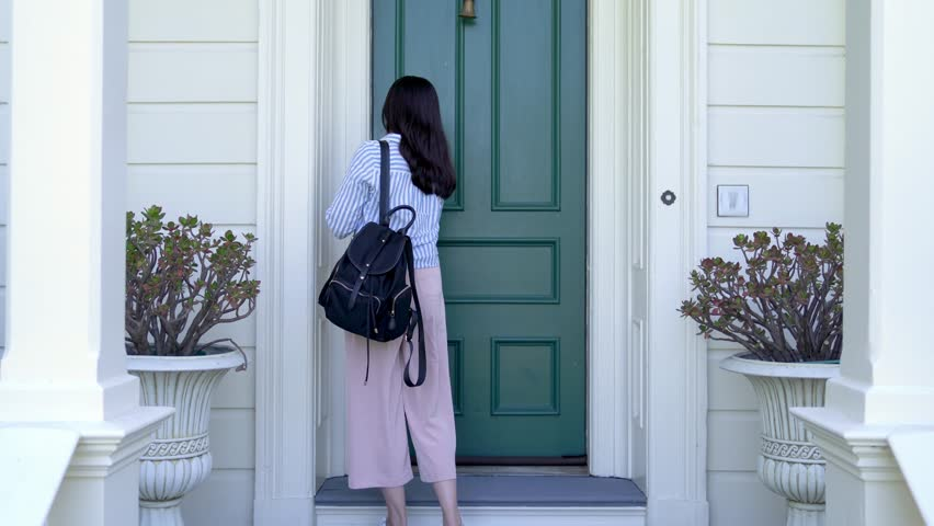 Asian woman leaving home to work and locking door of apartment. white house with green front door; traditional house design. security safety lock concept. | Shutterstock HD Video #1020640957