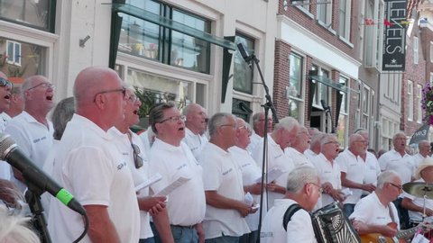 "Harlingen, Friesland / Netherlands - 08 04 2018: Shanty choir ""Schip Ahoy"" is performing"